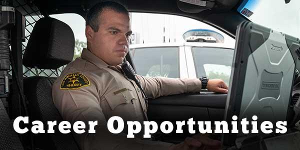 Deputy working on Laptop in a patrol car