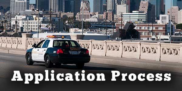 Patrol car crossing bridge into Los Angeles