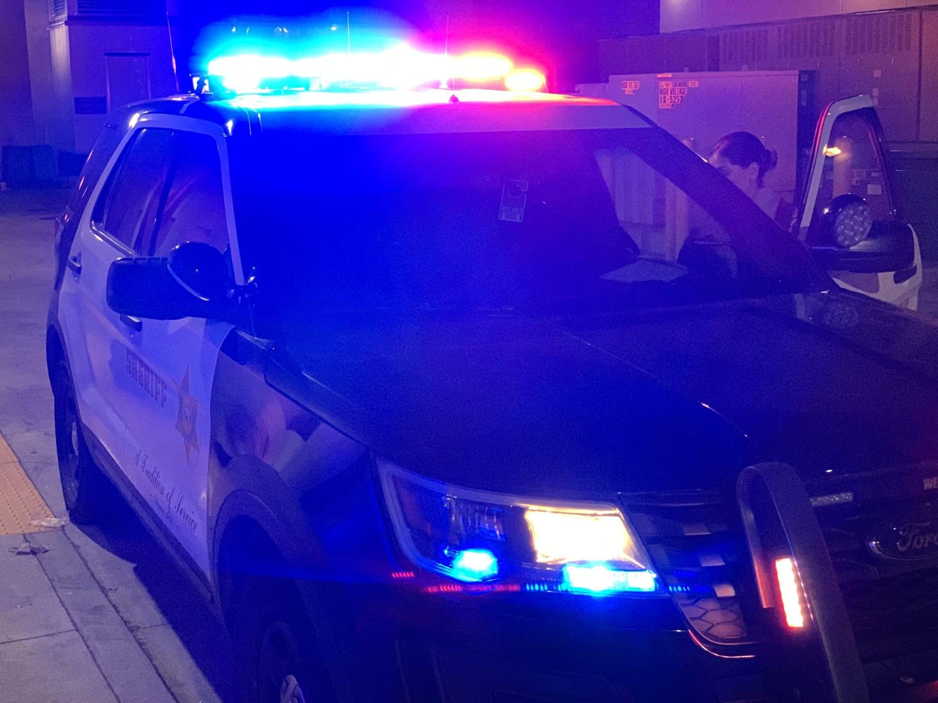 Patrol car with red lights on
