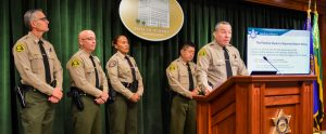Sheriff Villanueva speaking to media from podium.