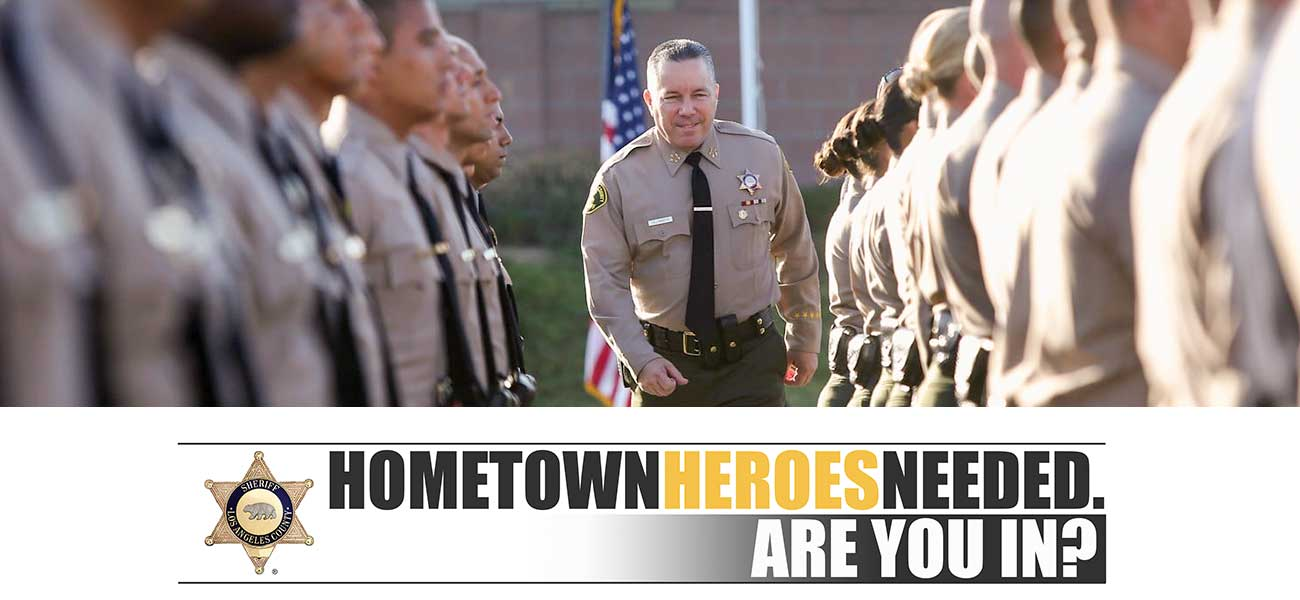 Sheriff walking down a row of graduates during inspection. Hometown heros needed. Are you in?