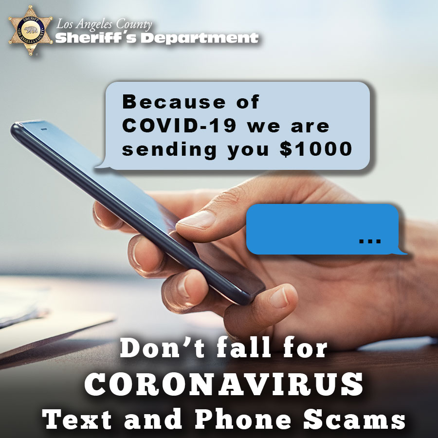 "Person using a mobile phone with a message from an unkown sender reading, ""Because of Covid-19 we are sending you $1000"""