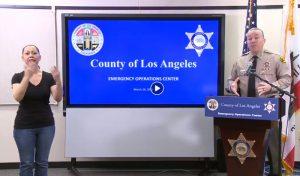 Sheriff Villanueva holding a press conference
