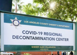 Large sign that reads, : Covid-19 Regional Decontamination Center.