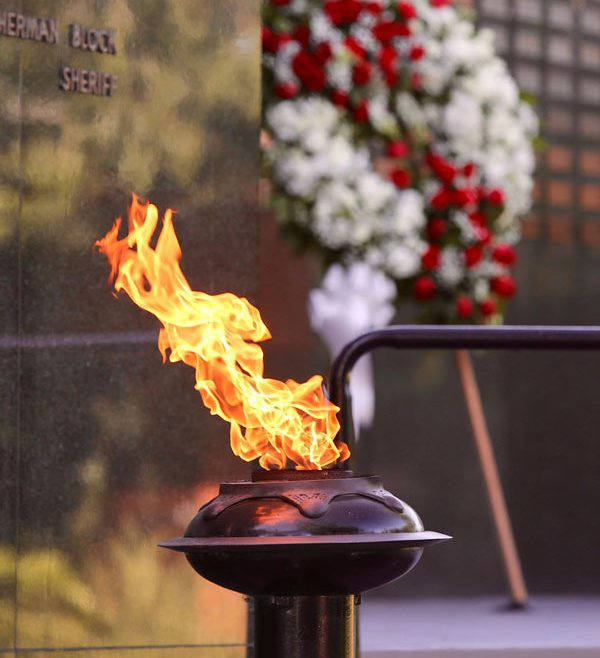 Ceremonial flame in front of the Memorial wall
