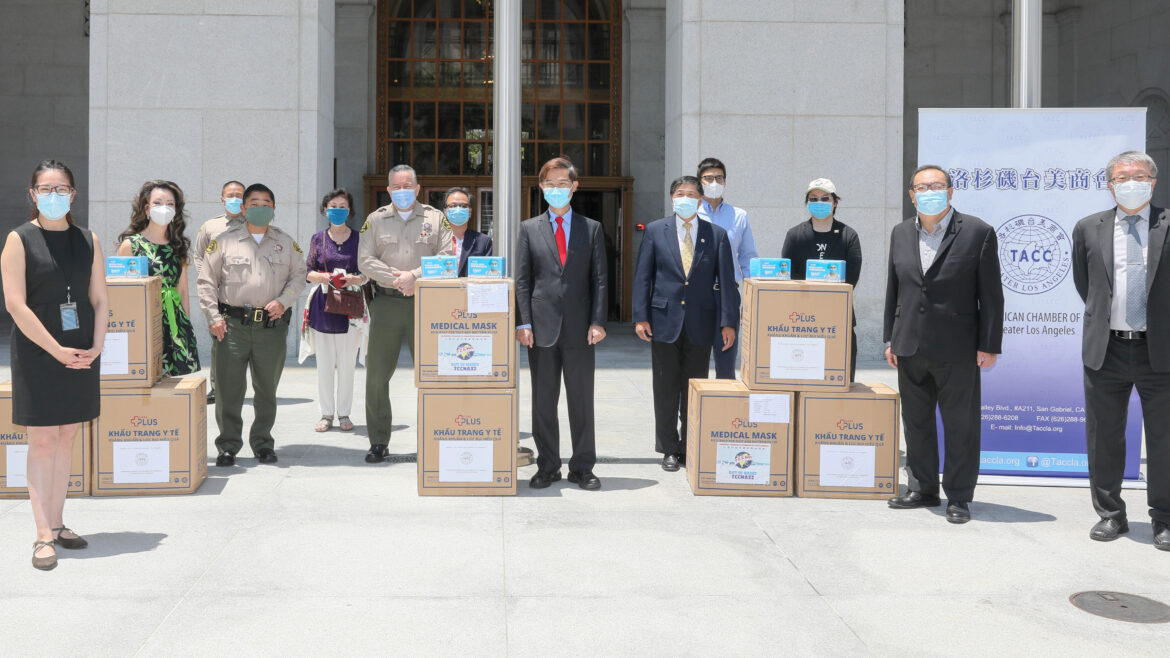 Sheriff and Undersheriff standing with boxes of masks and the TCCLA