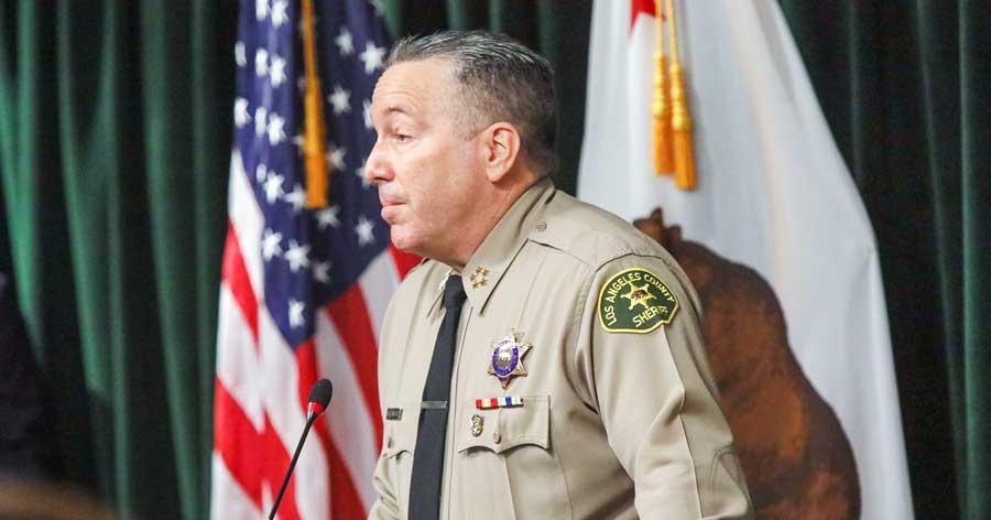 Sheriff Alex Villanueva infront of media giving a conference