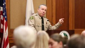 Sheriff speaking passionatly at a Town Hall