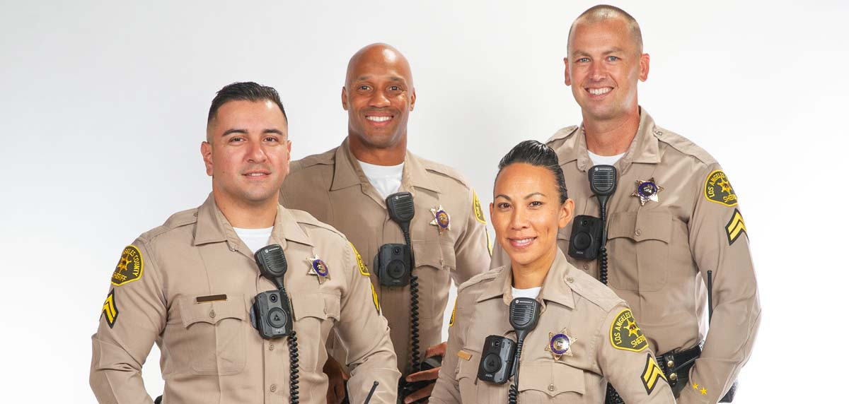 Group photo of deputies fitted with body cameras