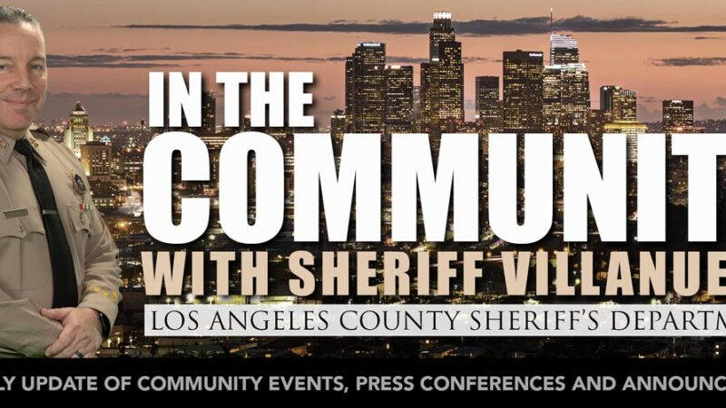 Picture of Sheriff Alex Villanueva infront of the L A City Skyline, Text reads, In the Community with Sheriff Villanueva – Los Angeles County Sheriff's Department. Monthly Update of Community Events, Press Conferences and Announcements