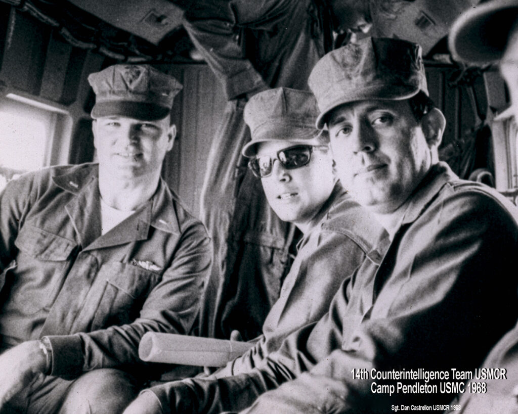 image of vetter next to two marines inside of a heliocoptor. Vintage black and white image.